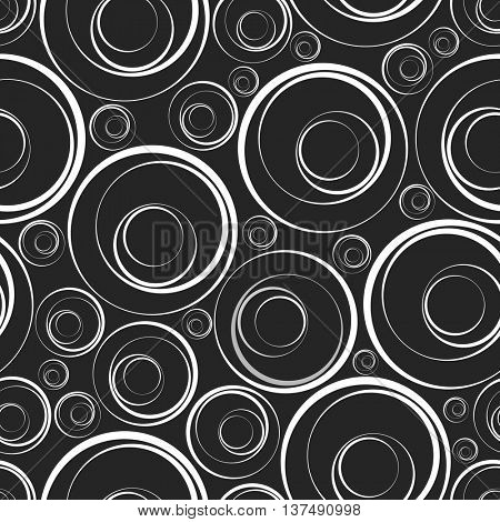 Seamless background. Rings of different sizes on a dark background.
