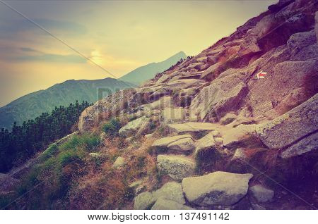 Summer mountain landscape at sunset in vintage style. Mountain trail in High Tatra Slovakia.