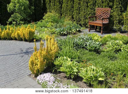 Bench in a decorative garden. Spring time.