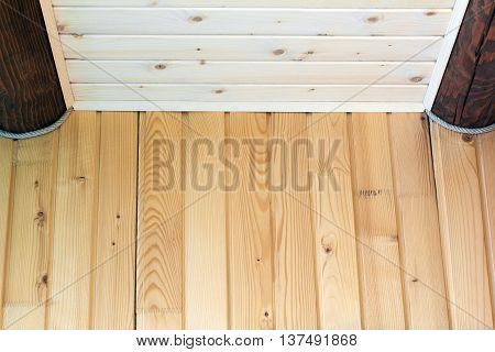 A log cabin wall built from log oak and wooden lining from a pine as a background