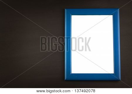 Photo picture frame at black wooden background. Place your ad text. Invitation card.