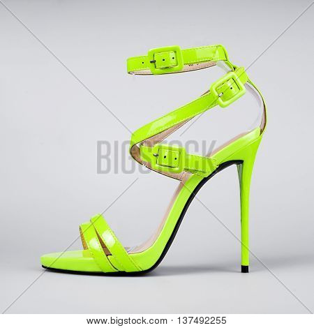 yellow sandals for women in grey background