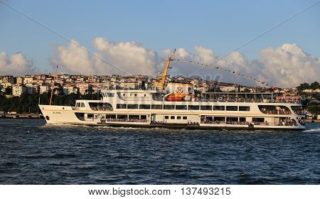 ISTANBUL TURKEY - JULY 06 2016: Sehir Hatlari ferry carry passengers between Asian side to European side of Istanbul. Sehir Hatlari was established in 1844 and now carries 150000 passengers a day.