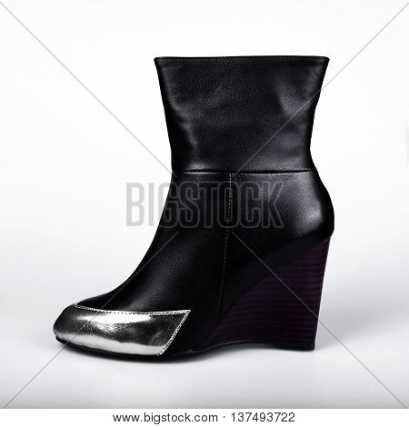 black female boots in a grey background
