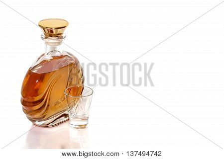 Bottle of tequila and a shot on a white background