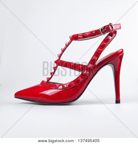 summer female red shoes over white background