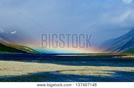 rainbow over the mountain lake  in Polar Ural, Russia