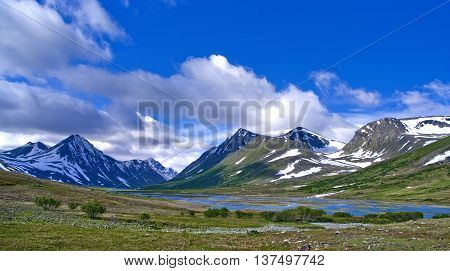 Mountain landscape in green wally with crystal river. Polar Ural