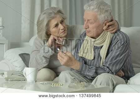 Portrait of elderly man and woman with flu