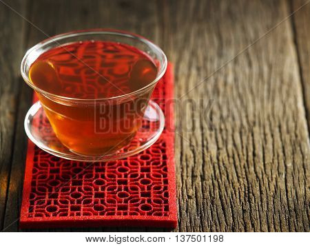 chinese tea cup on the wooden background