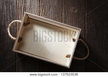 wooden crate on the old wooden background