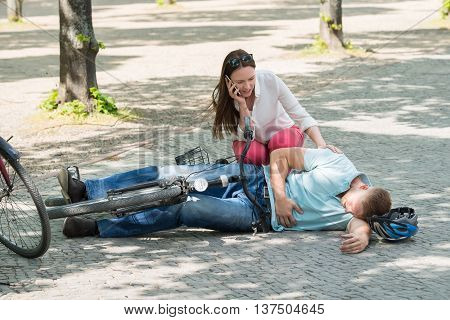 Worried Woman Calling For Help After Man Getting Injured By Falling From Bicycle