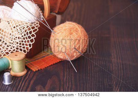 Casket With Needlework And Beige Skein Of Thread