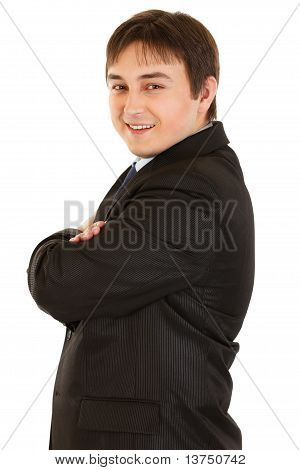 Smiling young businessman with crossed arms on chest isolated on white