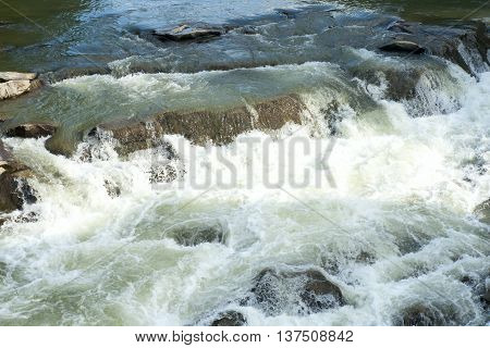 Mountain River Water Waves And Bubbles. Water Background And Texture