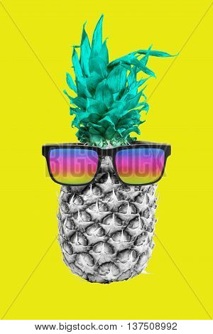 Happy summer concept idea fun black and white pineapple fruit wearing hipster sunglasses on colorful background. Includes clipping path.