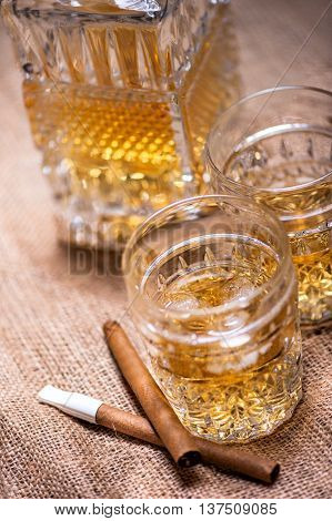 Close Up Of Cigar And Whiskey Glasses