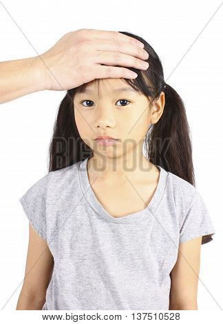 Sick child with hand on forehead on white background.