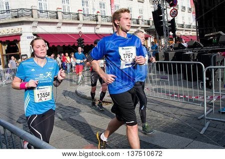 OSLO NORWAY - SEPT 20: Unidentified marathon runners at marathon on Sept 20 2014 in Oslo Norway