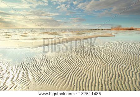 Ijsselmeer lake coast at low tide Hindeloopen Netherlands