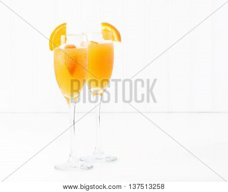 The cocktail known as a mimosa contains orange juice and champagne.