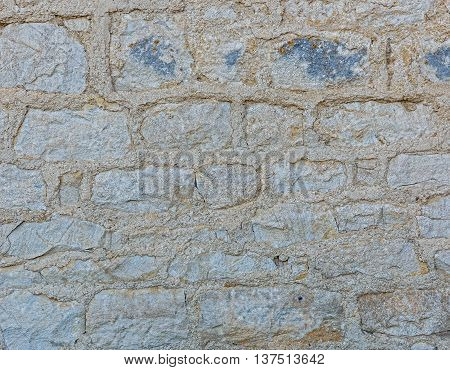 The wall was built of stone with wide seams close-up