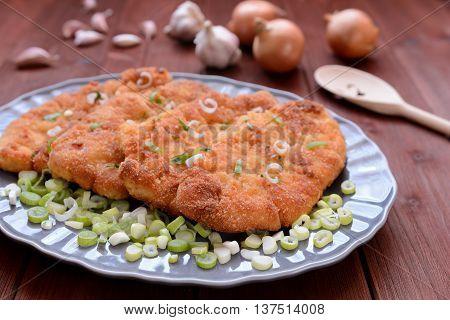 Traditional pork Wiener schnitzel on a gray plate