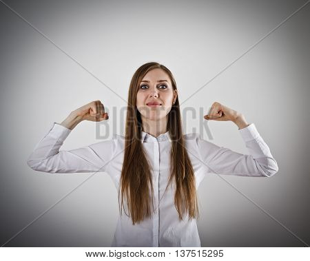 Young woman in white. Strong woman concept.