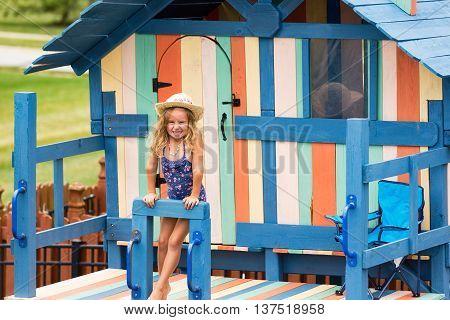 Happy Little Girl On Outdoor Playset