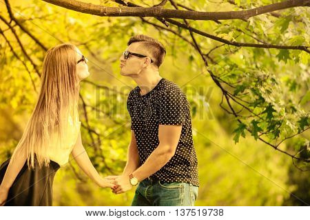 Couple In Park Share A Kiss.