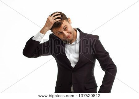 Portrait of handsome businessman wearing black suit isolated on white put his hand on his head