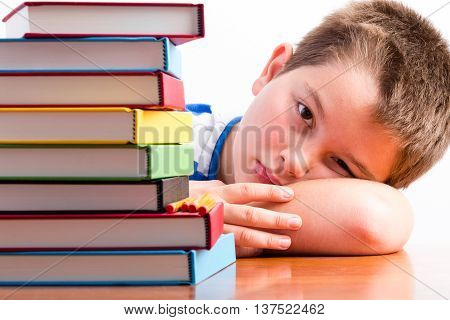 Depressed Young Schoolboy Eyeing His Textbooks