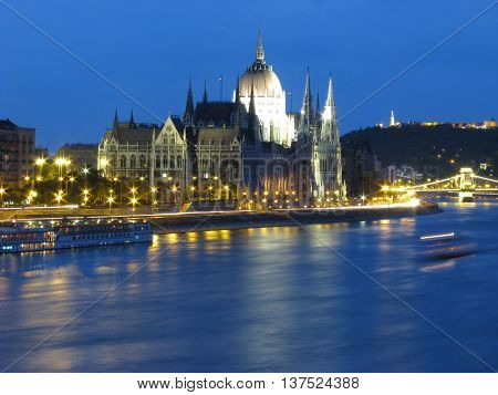The Danube river and riverbank with the parliament in Budapest at night