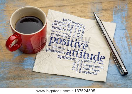 positive attitude word cloud - handwriting on a napkin with a cup of coffee