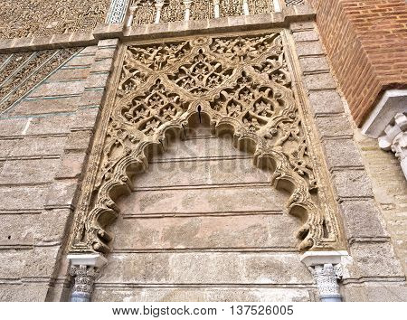 SEVILLE, SPAIN - September 12, 2015: Detail of the mudejar facade of the King Peter of Castile in the Alcazar Royal of Seville on September 12, 2015 in Seville, Spain