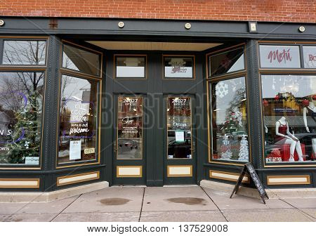 PLAINFIELD, ILLINOIS / UNITED STATES - DECEMBER 29, 2015: One may have one's hair cut at Sharp Designs, and purchase women's clothing at the Me Tu Boutique Bella, inside the historic Opera House Block Building in downtown Plainfield.