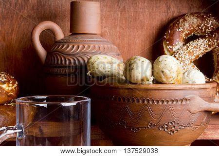 Traditional German sausages and pottery on a wooden background