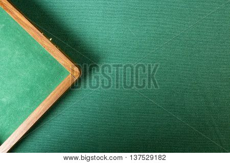 Table with green felt poker chips and box