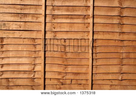 Orange Wood Stained Fence Background.