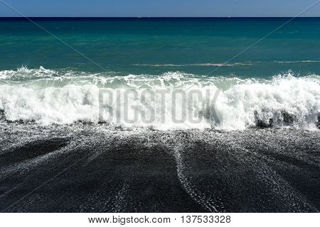 Waves In The Sea. Black Sand Volcanic Beach