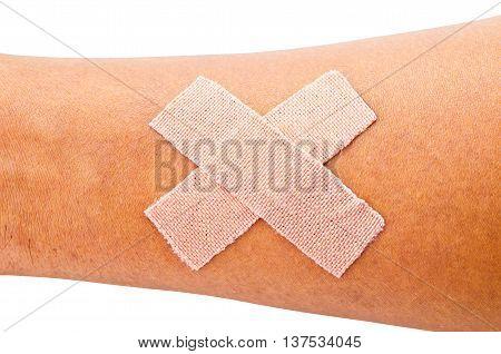 Adhesive bandage on man arm isolated on white background.