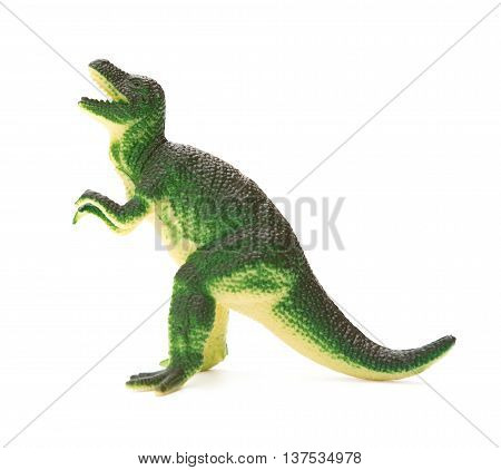 side view green plastic dinosaur toy on a white background