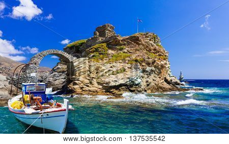 Scenery of Greek islands - Andros, View with ancient fortress and fishing boat