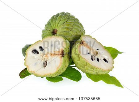 whole and half cut custard apple with leaves on white background