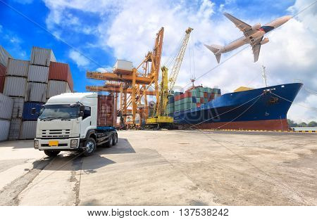 Ship for container with working crane bridge in shipyard with truck for Logistic Import Export background