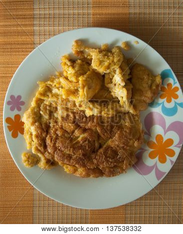 Thai food omelet with pork on mat