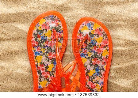 Female Beach Sandals On Sand Background