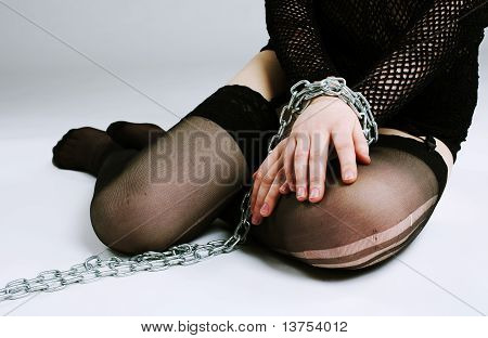 Young girl in chain on hands