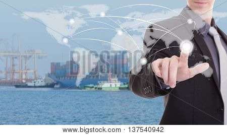 hand presses on world map Industrial Container Cargo freight ship at dusk for Logistic Import Export background (Elements of this image furnished by NASA)