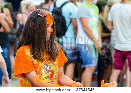 GOMEL BELARUS - JULY 6 2016: Young people are celebrating festival of colors (Holi Festival or ColorFest) in Gomel Belarus
